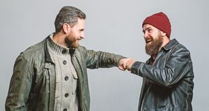 Real friendship mature friends. Male friendship concept. Brutal bearded men wear leather jackets. Real men and. Brotherhood. Friends glad see each other royalty free stock images
