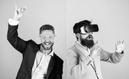 Real fun and virtual alternative. Man with beard in VR glasses and louvered plastic accessory. Guy interact in virtual. Reality. Hipster exploring virtual royalty free stock images