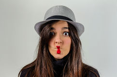 Real girl gesturing with her red lips over gray Stock Image