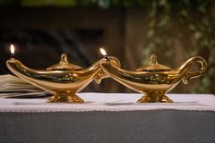 Real gold aladdin lamp. Detail royalty free stock photo