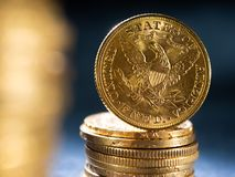 Gold coins over dark background. Real Gold coins over dark background stock photo