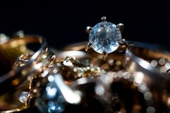 Real gold jewelry  with gems close up macro. Shot isolated on dark background Stock Images