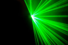 Real green laser lights. On black background Royalty Free Stock Images