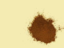 Real ground coffee on pale background. Closeup of some spilled ground coffee on cream coloured work surface stock photos
