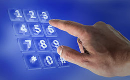 Real hand in a virtual keypad. 3d Stock Image