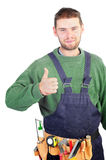 Real handsome carpenter showing thumb up Stock Photo