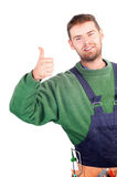 Real handsome carpenter showing thumb up Stock Image