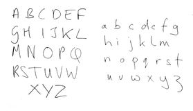 Real handwriting, rather untidy alphabet letters isolated on whi Royalty Free Stock Image