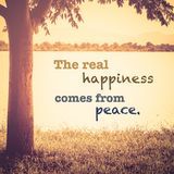 The Real Happiness Comes From Peace. Inspiration quote on nature background, retro color style Stock Photo