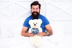 Real happiness. Love and happiness. bearded man teddy bear in bed. Gift box for holidays. nice present for you