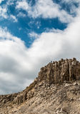 Real Heart shaped cloud in the sky above the high rocky mountains Stock Photography