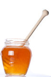 Real honey. In a jar  on white. Artistic selective focus Royalty Free Stock Photos