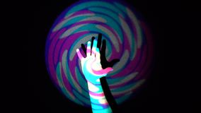 The human hand on background of colorful tunnel flythrough loop. The real human hand on background of colorful tunnel flythrough loop stock video footage