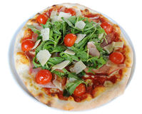 Real italian pizza. Italian pizza with ham, ruccola and parmesan cheese Royalty Free Stock Photos