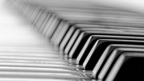 Real Ivory keyed piano. Ivory keyed piano in low depth of field and selective focus. Real ivory keys can be recognized by the fingerprint like pattern on their royalty free stock image