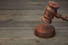 Real Judges Or Auctioneer Gavel On The Black Wooden Table. Real Judges Or Auctioneer Gavel Made From Walnut Wood On The Black Wooden Table In Spot Light, Front Royalty Free Stock Photos