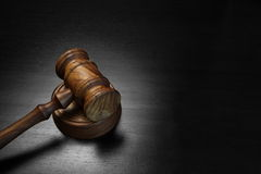 Real Judges Or Auctioneer Gavel On The Black Wooden Table Stock Photos