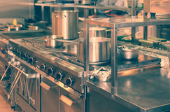 Real kitchen of a restaurant, toned Royalty Free Stock Image