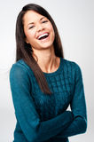 Real laugh. Carefree portrait of a woman laughing and having fun. real person on grey background Royalty Free Stock Photos