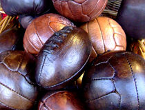 Real leather balls. Bunch of real leather balls, old fashioned in a brushwood bucket royalty free stock images