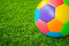 Real leather Colorful multi colour Soccer ball on green grass . Stock Images