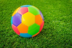 Real leather Colorful multi colour Soccer ball on green grass . Royalty Free Stock Photography
