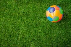 Real leather Colorful multi colour Soccer ball on green grass . Royalty Free Stock Images