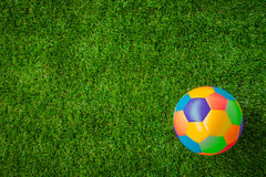 Real leather Colorful multi colour Soccer ball on green grass . Stock Photos