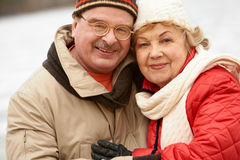 In real life. Happy aged family looking at camera during winter vacation royalty free stock photos