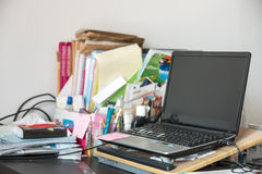 Real life messy desk in office Royalty Free Stock Photos