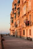 Real life on Valletta street - clothes drying on typical maltese balcony. Real life on Valletta street during orange sunset - clothes drying on typical maltese Stock Image