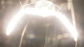 Real light bulb flickering. Real light bulb turning on, flickering and turning off. Incandescence thread, close up stock video footage