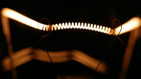 Real light bulb flickering. Real light bulb turning on, flickering and turning off. Incandescence thread, close up stock footage