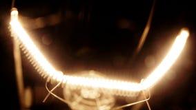 Real light bulb flickering stock video