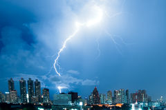 Real lightning bolt strike in a city Stock Photos