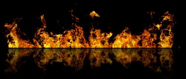 Real line of fire flames with reflection isolated on black background. Mockup on black of wall of fire. Real fire line flames with reflection isolated on black Stock Images