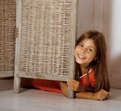 Real little cute brunette girl at home smiling. Close up, real interior royalty free stock images
