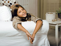Real little cute brunette girl at home smiling Stock Photos