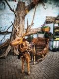 Real looking wooden deer royalty free stock photos