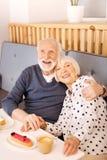 Jovial senior couple hugging stock photos