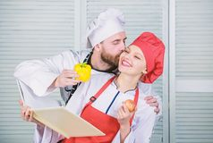 Real love. vegetarian. cook uniform. Dieting vitamin. culinary. happy couple in love with health food. man and woman royalty free stock images
