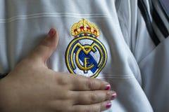 Real Madrid emblem. Spanish football club Real Madrid emblem on football shirt Stock Images