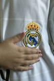 Real Madrid emblem. Spanish football club Real Madrid emblem on football shirt Royalty Free Stock Photo