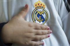 Real Madrid emblem. Spanish football club Real Madrid emblem on football shirt Stock Photography