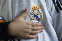 Real Madrid emblem. Spanish football club Real Madrid emblem on football shirt Stock Photo