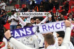 Real Madrid fans with scarves Stock Photo