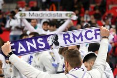 Real Madrid fans with scarves Stock Photos
