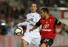 Real Madrid sergio Ramos fighting the ball. Real Madrid sergio Ramos fight the ball with mallorca Navarro during their first division soccer game in Mallorca Stock Photo