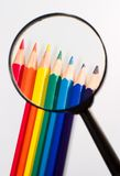 Real magnifier and pencil Stock Photos