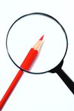 Real magnifier and red pencil Stock Photo